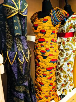 Three dresses on museum forms